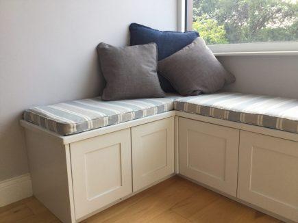 Bedroom design with corner window seat