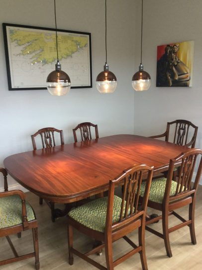 Dining area design using antique table and chairs/pendant lighting
