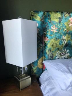 Bedside lamp and bespoke headboard detail of bedroom design