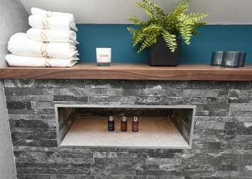 Feature shelf with light in bathroom design