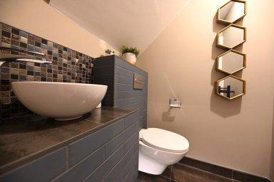 Guest bathroom under a stairs design