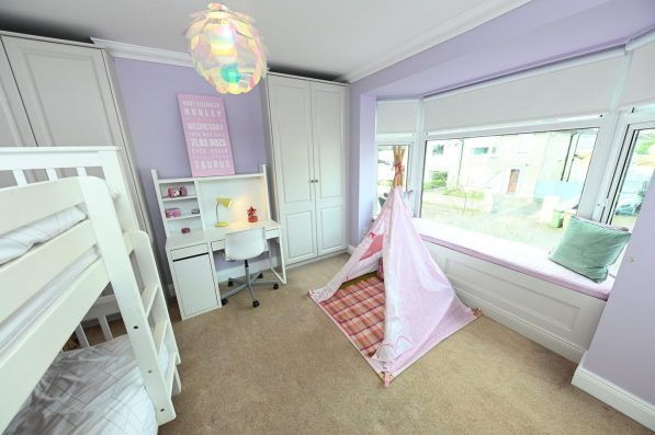 Childs bedroom design with window seat