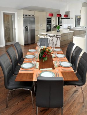 Dining area design using walnut table/grey leather chairs