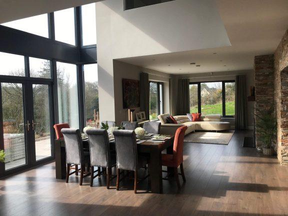 Living Dining area with grey and orange theme - Sinead Cassidy Design