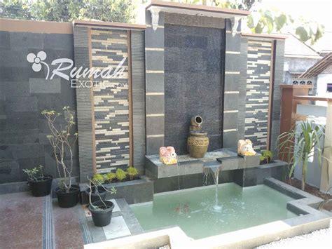 desain kolam ikan taman minimalis batu alam