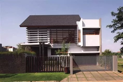 material batu alam tampak depan rumah minimalis