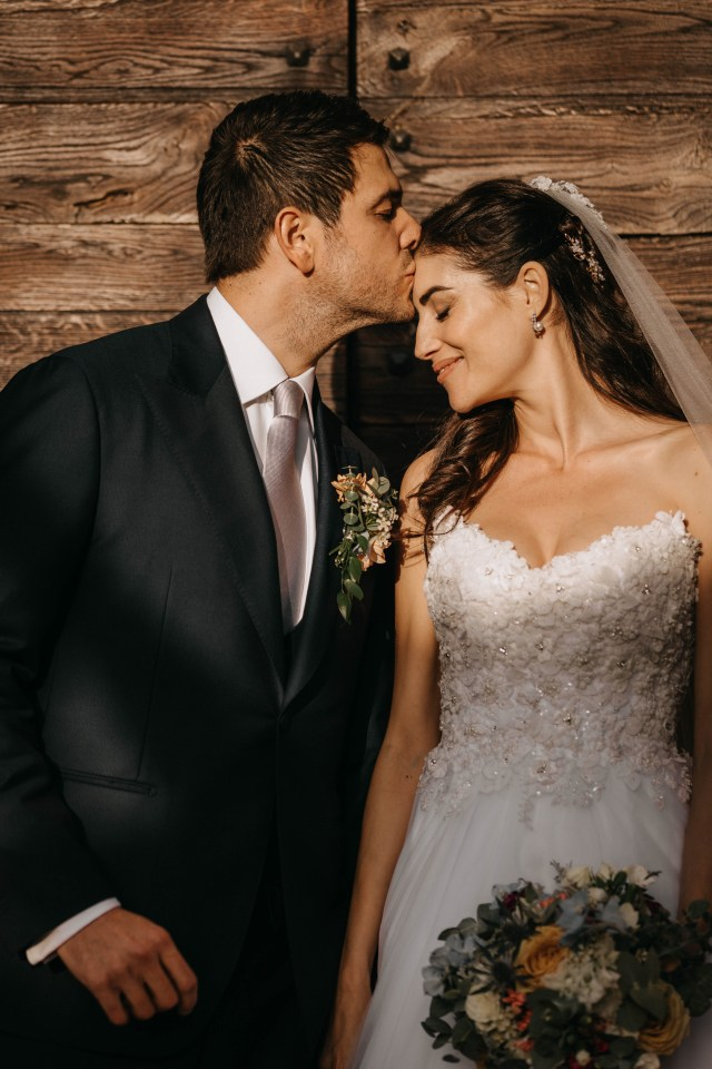 Bride and groom kissing during the shooting