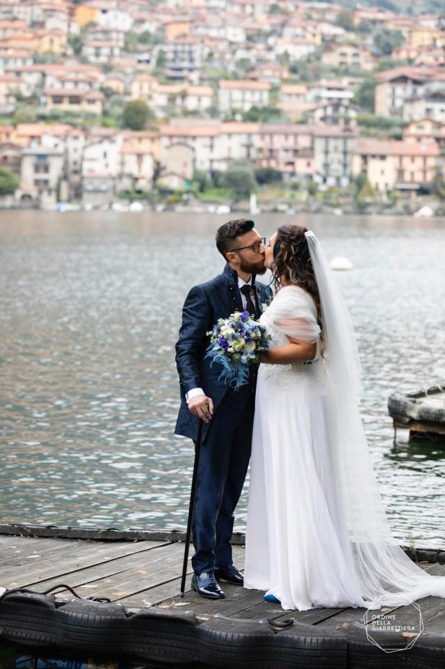 Bride and Groom kissing on Como lake