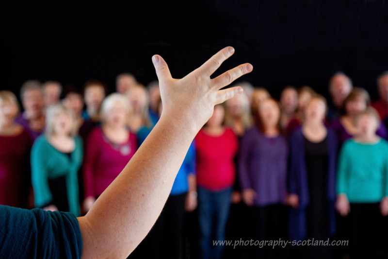 Ali Burns conducting the SongTribe choir in Edinburgh