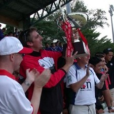 Singapore rugby skipper Chris Gilbert lifts the Asian Rugby Championships Division One trophy