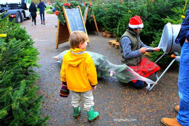 This kid was jumping with excitement as they were about to take their Christmas Tree home. Happy Soul.