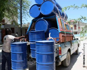 delivery of oil drums for Haiti art