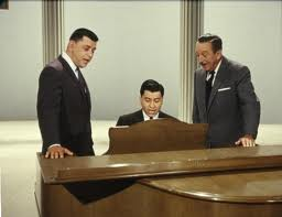 The Sherman brothers with Walt Disney