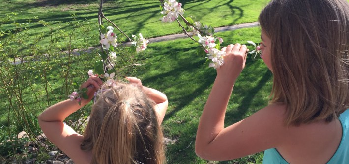 Girls smelling flowers