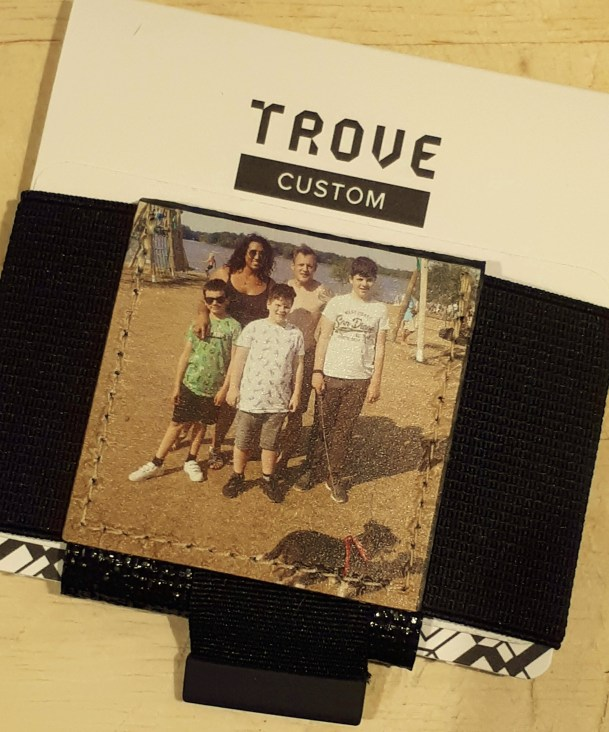 A Trove Wallet on a table, created by me so features a family photo.
