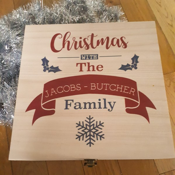 A wooden box with the words Christmas with the Jacobs Butcher family written on it