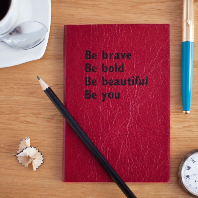 red journal with the words be brave, be bold, be beautiful, be you on the front cover