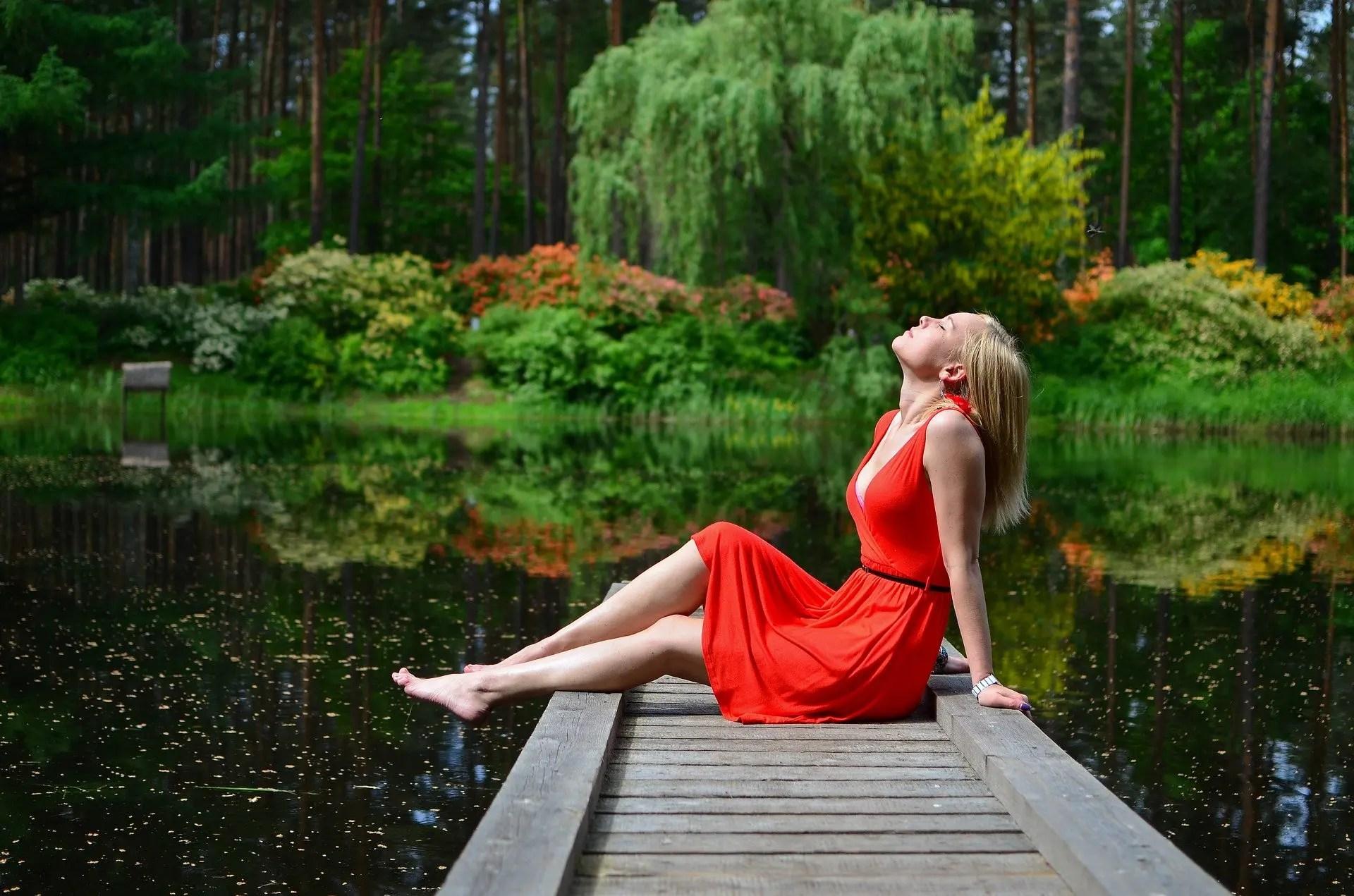 Woman sitting amongst nature