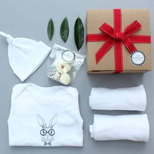 Pure White Baby Hamper Company set on a flat lay