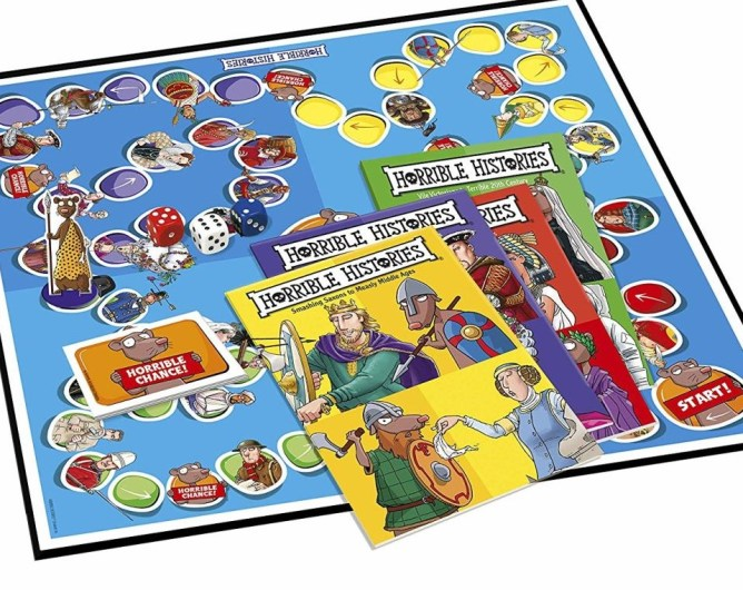 The Horrible Histories board game open.