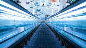 tech stories escalator vanishing point blue grey