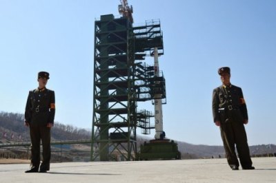 KPA Soldiers in front of the Unha-3 rocket at Tangachai-ri space centre in North Korea on April 8, 2012 (AFP/File, Pedro Ugarte)