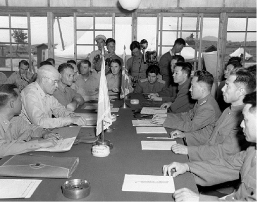 MGen. Bryan (2nd from left), Senior Member of the Military Armistice Commission, United Nations' Command, exchanges credentials with MGen. Lee Sang Cho, North Korean Army (3rd from right), Senior Communist delegate, at Panmunjom, Korea, on July 28, 1953, the day after the Korean War Armistice went into effect. | Official U.S. Army photo, Signal Corps Collection; courtesy of the National Archives.