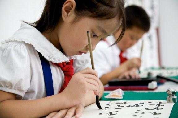 North Korean child writing