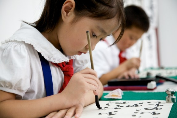 North Korean child writing
