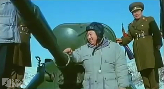 Kim Jong-un, standing, appropriately, in front of a tank. | Image: KCTV