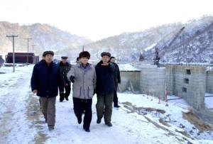 DPRK Premier Pak Bong-ju assesses dam construction on Chongchun River, January 2014. Image via Rodong Sinmun.
