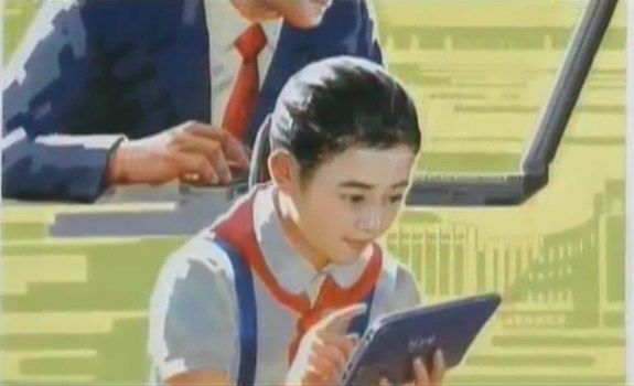 A North Korean girl uses an 'Arirang' brand tablet computer. Image via Mansudae Art Studio Poster Exhibition, Chosun Central TV, January 2014.