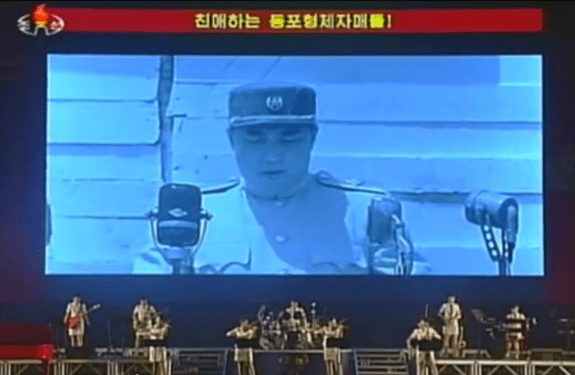 The Eternal President addressing his followers in summer 2013. | Image: Moranbong Band concert 3 August 2013; Youtube.