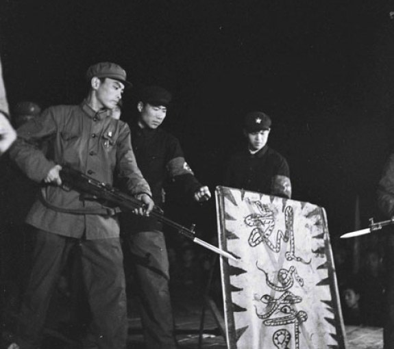 "Red Guards in Yanbian Menace the Purged and Snake-like ""Liu Shaoqi,"" circa 1967; Image via Ryu Eunkyu."