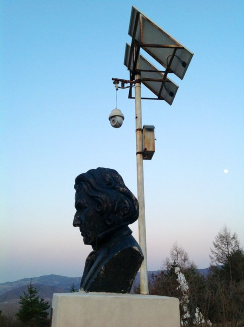 A bust of Ludwig van Beethoven -- and Chinese surveillance -- looms over the North Korean frontier in Tumen | Photo by Adam Cathcart