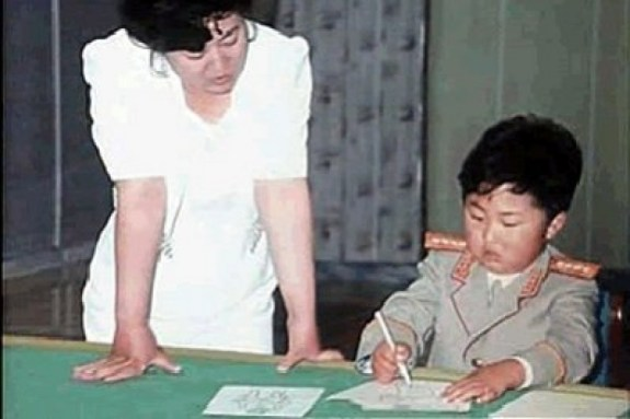 Kim Jong-un as a child, being taught the ways of a revolutionary. | Image: KCNA