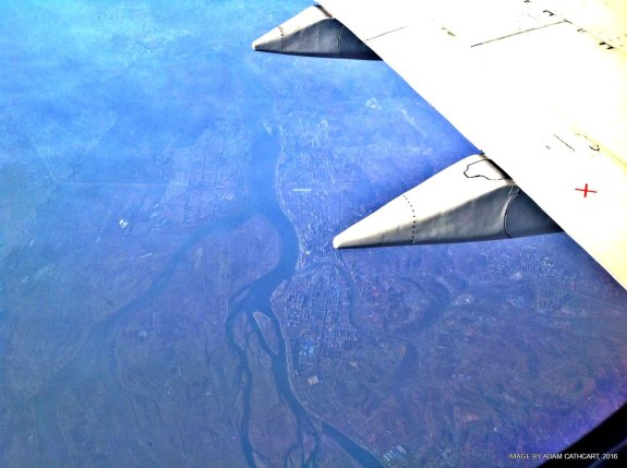 A view of Sinuiju (left) and sprawling Dandong (right) from an Air Koryo flight from Pyongyang in spring 2016. Photo by Adam Cathcart.