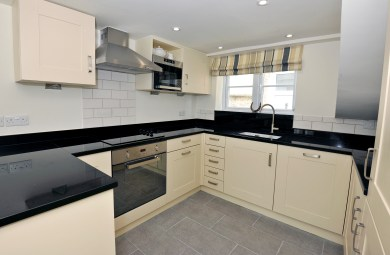 Grey black and cream contemporary kitchen in small country cottage