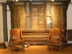 Carved wooden wall panels furnished with traditional leather chairs