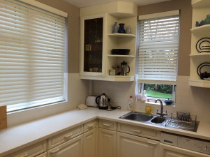 After painting dark kitchen units replacing the work top and tiles the kitchen is brighter