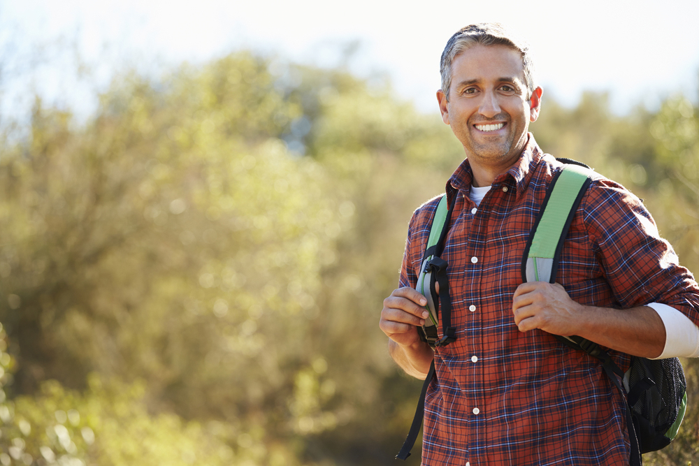 man smiling with backpack