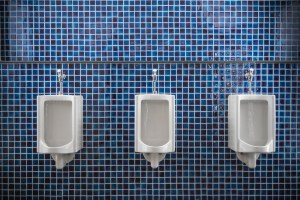 three urinals against the wall