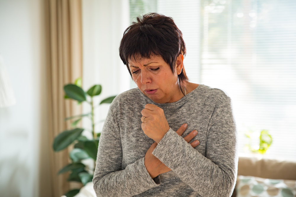 woman coughing in the living room