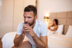 Young couple angry with each other in bed
