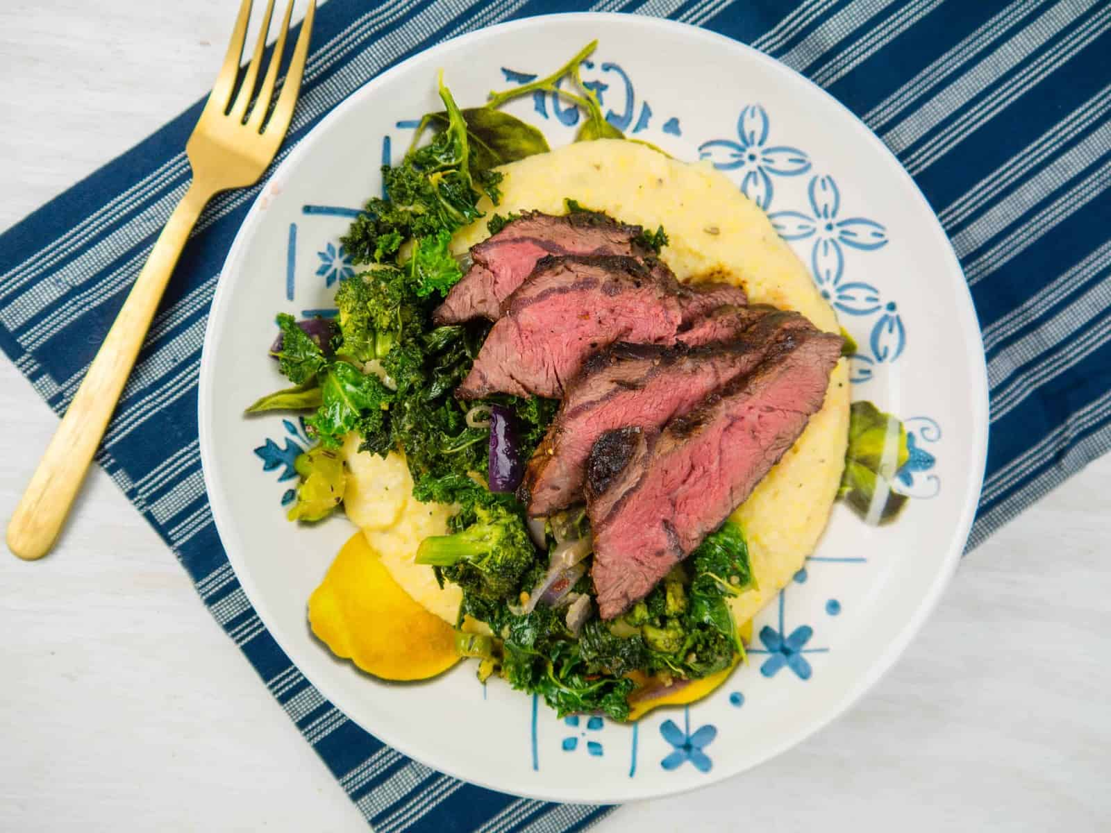 Cheesy Polenta with Grilled Steak and Garlicky Greens