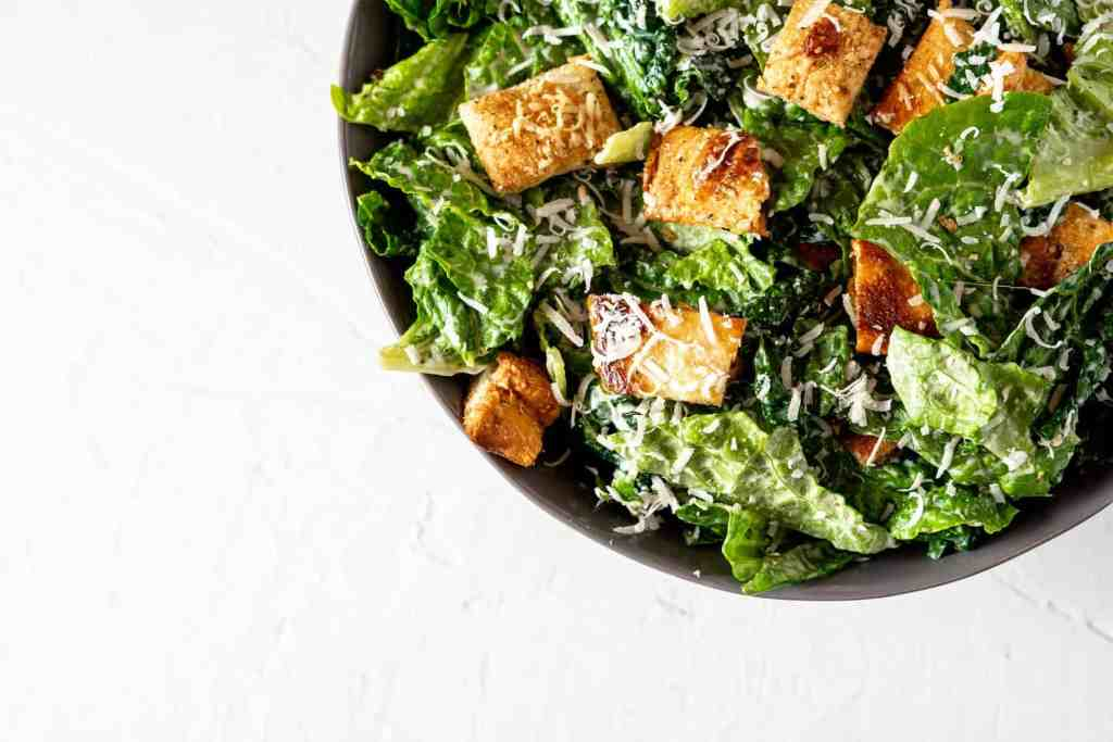 Kale Caesar Salad with Pizza Crust Croutons | Sip and Spice