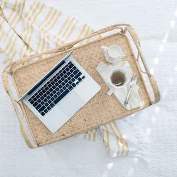 feature Learn how to get your blog noticed by brands computer on bed with tray and tea min