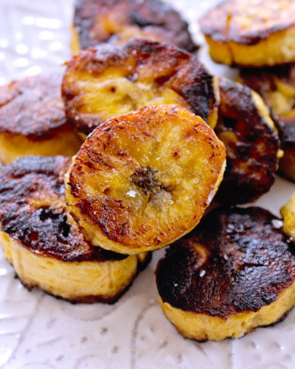 caramelized fried sweet plantain slices in a pan