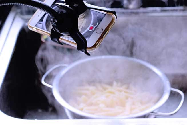 rigatoni pasta drained in the sink after boiling while being filmed for food blog