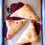 Fresh raspberry puff pastry turnovers finished in the oven with an egg wash-1
